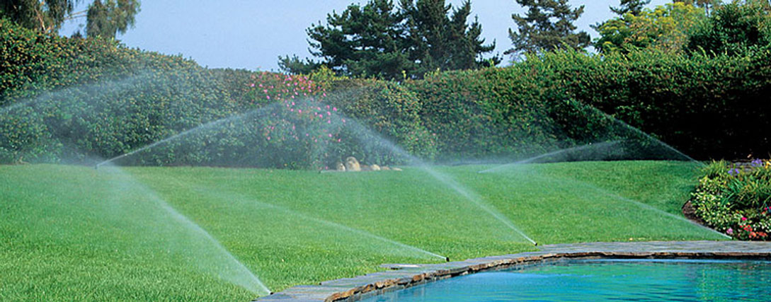 several sprinklers keeping lawn green